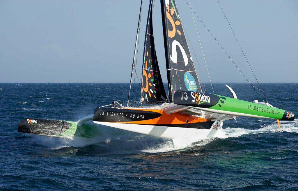 091014-Naviguation solo, entrainement pour la Route Du Rhm 2014, au large de Belle-Ile. Trimaran SODEBO ULTIM', skipper, Thomas Coville. Reportage hélico.
